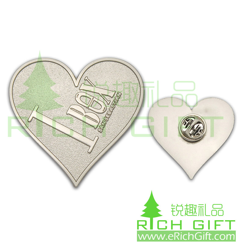 Heart shape San Sebastian pin with raised metal logo