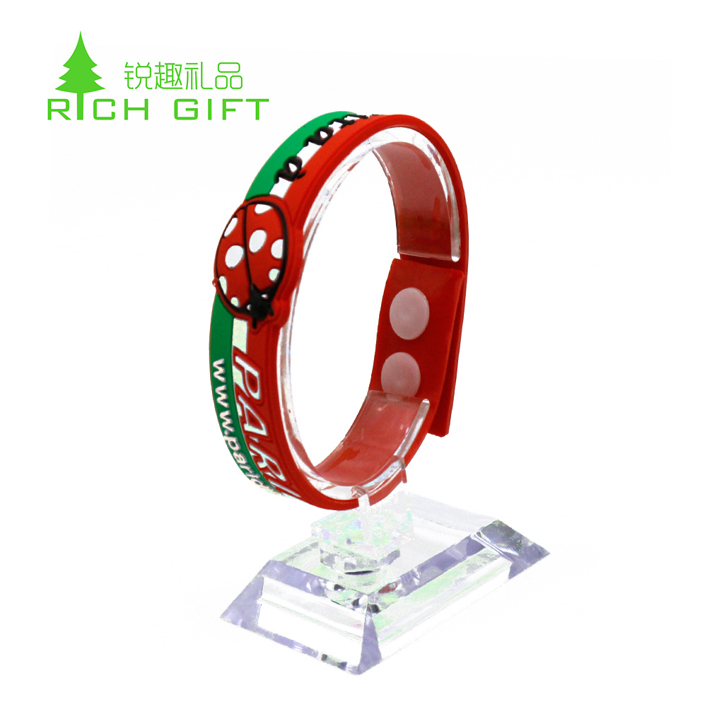Made in china custom silicone rubber souvenir wristband bracelet with holes for children